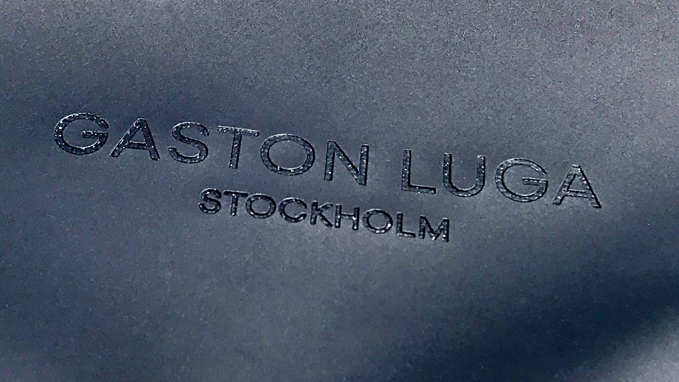 Guston Luga ロゴ部